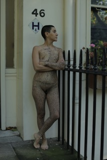 Mania Akbari outside Virginia Woolf's house, 46 Gordon Square. From Mania Akbari and Mark Cousins, Life May Be