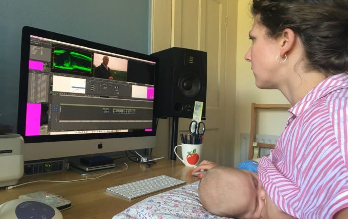 Kirsty Robinson breastfeeding son while editing