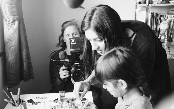 Image of Annemarie Lean-Vercoe on camera, Manjinder directing her daughter, Lyla.