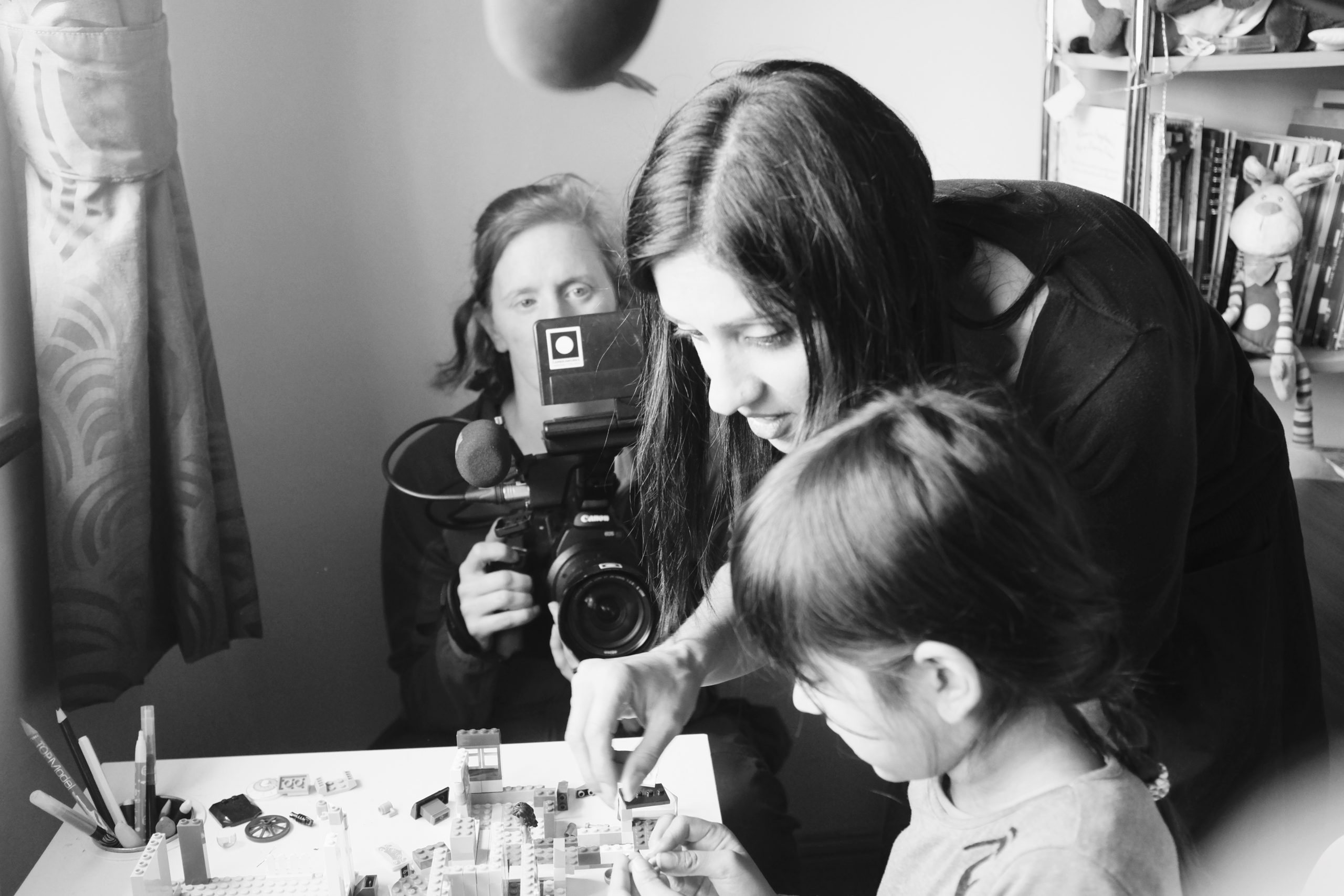 Image of Annemarie Lean-Vercoe on camera, Manjinder directing her daughter, Lyla.