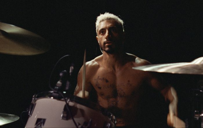 Image of Asian male playing drums, official photo from the film Sound of Metal