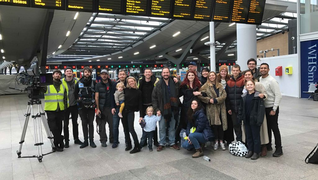 The crew of a film production stood at a train station