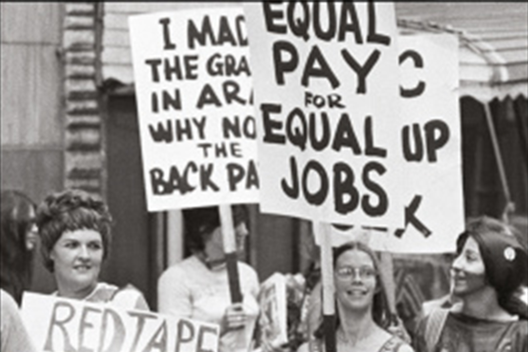 Section of book cover showing women holding placards